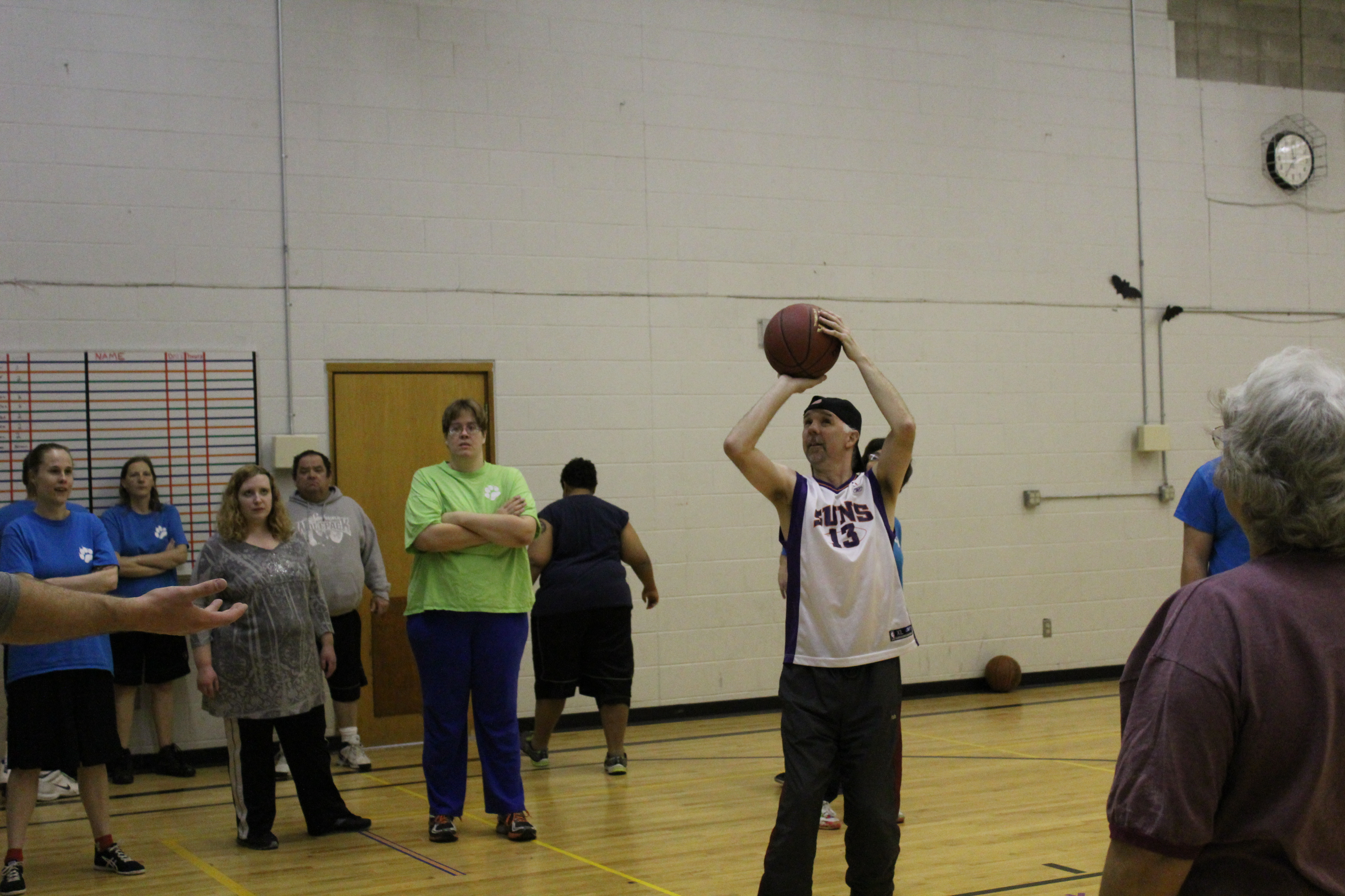 Shooting practice at basketball practice.