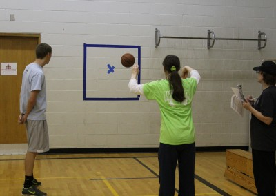 Practicing passing skills at basketball practice
